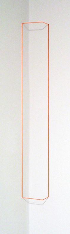 "Fred Sandback  Orange Day-glo Corner Piece, 1968/2004  Orange day-glo acrylic on 1/32"" Elastic Cord & Spring Steel  Edition of 25, AP 1/3"