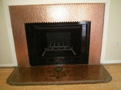 fireplace with pennies | Finished penny fireplace | Budget projects