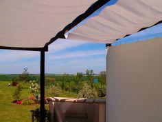 Toile d'ombrage sur ma terrasse bois