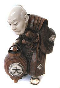 Antique carving of old man with lantern. Terrific
