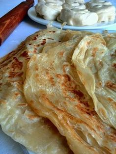 Roti is the Malay word for unleavened bread and is often served with curries instead of rice. Soft Roti Recipe, Roti Canai Recipe, Bread Recipes, Snack Recipes, Cooking Recipes, Feast Of Unleavened Bread, Roti Bread, Scones, Dressings