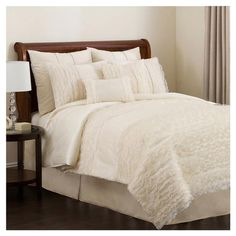 Four-piece silken bedding set.    Product: 1 Comforter, 1 bedskirt and 2 shams    Construction Material: 100% Pol...