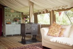Child-friendly glamping holidays in yurts & safari-style tents on a family-run farm in unspoilt countryside near Sidmouth in Devon, South West England.