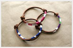 These DIY leather friendship bracelets are so fun and easy to make. Add a pop of color to your arm candy.