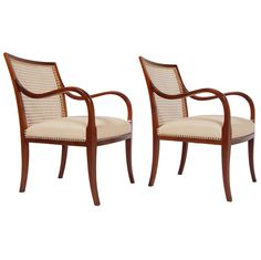 Pair of Armchairs by Frits Henningsen | From a unique collection of antique and modern armchairs at http://www.1stdibs.com/furniture/seating/armchairs/