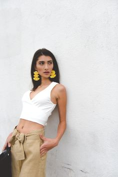 Minimalist Outfits Summer Outfits White Wrap Tank White crop top wrap top tie front pants linen pants cropped wide leg pants slides yellow tassel earrings black day clutch