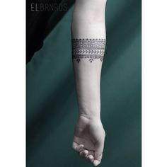 Ornamental style arm band tattoo on the left forearm. Tattoo artist: Elda Bernardes