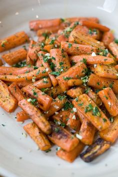 Roasted Carrots with Gremolata is one of my personal favorite side dishes. It's perfect for the holidays or anytime: Carrots and shallots roasted until the edges are a crispy brown and then sprinkled with a zesty gremolata. Low Carb Side Dishes, Healthy Side Dishes, Heart Healthy Recipes, Side Dish Recipes, Vegetable Recipes, Real Food Recipes, Healthy Snacks, Vegetarian Recipes, Healthy Eating