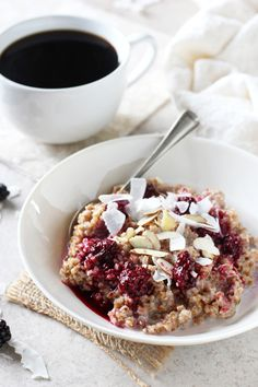 Recipe for creamy blackberry coconut bulgur breakfast bowl. With whole grain bulgur as the base and topped with a blackberry sauce, coconut and nuts! | Cookie Monster Cooking