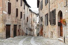 Photo made in Castell'arquato in the province of Parma (Italy). The picture shows one of the typical streets of the medieval village that is at the beginning of val Darda. The houses are built with face brick and cobblestone street.