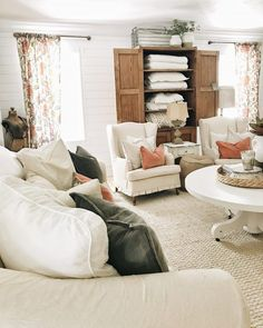 Adding Color To The Front Living Room- lovely cottage style living room. A great pin for farmhouse and cottage decor inspiration!