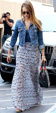 Jessica Alba's her flowy Show Me Your Mumu maxi in a unique print and her cropped denim jacket (which perfectly complements the skirt's colors).