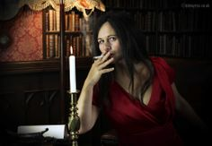 Author Sara Sheridan as Miss Scarlet, in the library, with the candlestick. Created as part of a series of images of authors as characters for Wigtown Book Festival. For more about this photo shoot, visit my blog post: http://kimayres.blogspot.co.uk/2013/02/miss-scarlett-in-library-with.html