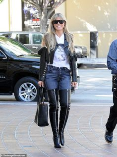 Kinky boots: Heidi Klum went for maximum sexy in thigh-high black leather boots with zips up the front when she arrived for first day of filming on AGT: Champions in LA on Thursday Heidi Klum, Leather High Heel Boots, Thigh High Boots Heels, Celebrity Boots, Sexy Boots, Thigh Highs, Lady, Jeans And Boots, Thighs