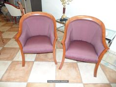 Lot 1198 - A pair of polished mahogany framed upholstered club chairs plum chenille type fabric