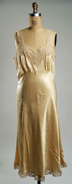 """1940s slip with lace trim and straps.  Silk, cotton.  Labelled """"Fischer""""."""