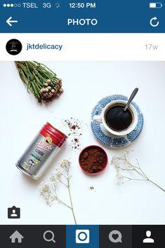 having premium coffee from Kapal Api.