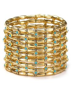 Cara Colored Stone Stretch Bracelet         PRICE: $45.00     Nail this season's eclectic jewelry trend with coil bracelet from Cara. Decorated with layers of gold stones, this bohemian piece will work just as well for day as for night. @bloomingdales.com