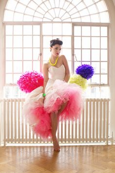 JANAY! This is awesome.... I've got some paper flower balls like this but they are in gold... would be fun to pop a color in the dress!    Pop of Color Wedding Dress