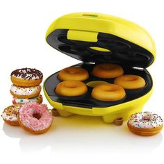 Freshly baked donuts right in your own home? Shut up and take my money! This delectable Donut Maker is an over-sized version of the delicious all-American treat. This easy to use appliance quickly creates 5 donuts in a matter of minutes. Cool Kitchen Gadgets, Cool Kitchens, Cute Kitchen, Kitchen Stove, Kitchen Cook, Cooking Gadgets, Cooking Tools, Cool Inventions, Kitchen Supplies