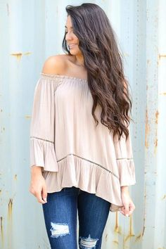Boho and beautiful! This off-the-shoulder top will be the perfect addition to your favorite wide-leg denim and wedges this fall. This top boasts bell sleeves and sophisticated eyelet detailing around