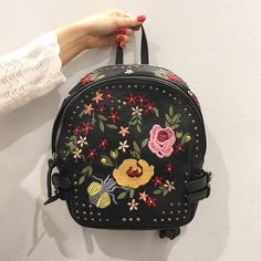 Our obsession with embroidery continues and this backpack is no exception. We'll be styling it with step hem denim and chunky knits.