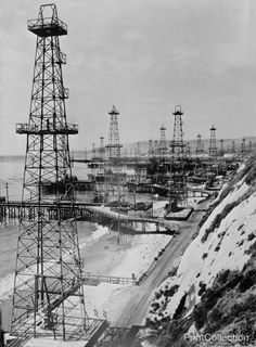 America's petroleum industries pour out fuel and lubricants for the United Nations. Oil well derricks on the beach along the coast of the U.S. Pacific coast state of California indicate how thorough i