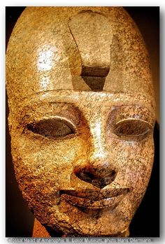 Colossal Head of Amenophis III. Red granite. Luxor Museum. Dynasty 18,middle to  late  years  of  Amenophis  III (1403-1365 BC) From his  vast temple at Quarna