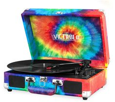 Spin those records--wherever you go--with the Victrola VSC-550BT suitcase record player. Page 1 QVC.com
