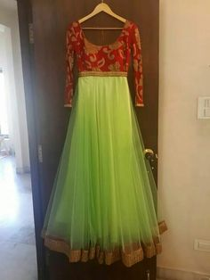 Lime green full sleeve anarkali with red yolk and gold emroidery. Mrunalini Rao.