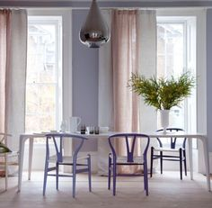 This is Add different intensities of the same pastel to the room. In this example (shown above) from Living Etc. on House to Home, palest lavender walls set the stage for a collection of chairs that feature increasingly dark versions of the same color. Eames, Murs Violets, Lavender Walls, Lilac Walls, Pastel Interior, Living Etc, Dining Room Design, Colour Schemes, Colour Combinations
