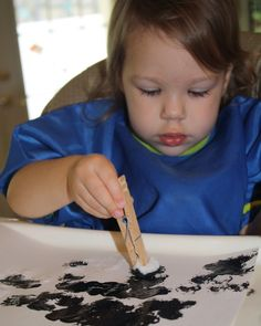 Paint with Pom Poms- clothes pins, pom poms and paint