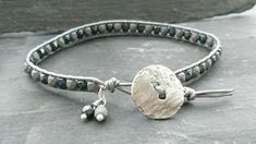 Mixed grey leather and glass bead bracelet with silver button £10.00