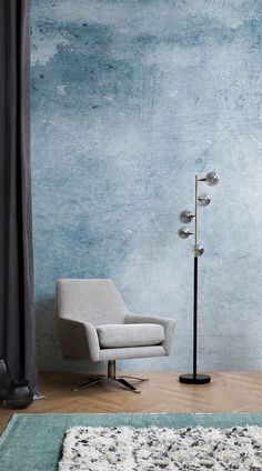 The simple use of the diverse hues of blue, combined with the grunge look, gives the canvas an inspiring and relaxing appeal that will make bedrooms a very cozy place to be. This watercolour wallpaper can make its living not just in the bedroom. This will be perfect in the bathroom, the dressing room, and suits the living room just fine. When placed as a supporting element to a vibrant room, this grunge wallpaper never fails to impress. #wallpaper #mural #livingroom #wallmural…