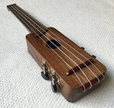 Nice woodworking project from Amy Qian. This (more) travel-sized ukulele project has been tremendously satisfying! The woodworking part filled me with unbounded joy, and hopefully the music part wi…