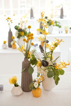 Modern event decor with fresh and paper flowers in yellow, white, green, and grey. Floral Design by hatchcreativestudio.com, Photography by daverobbinsphotography.com