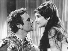 The story Cleopatra and Mark Antony's tumultuous romance was famously played out onscreen in 1963 by Elizabeth Taylor and Richard Burton. Richard Burton Elizabeth Taylor, Elizabeth Taylor Cleopatra, Burton And Taylor, Burton Richard, Queen Elizabeth, Movie Couples, Famous Couples, Hollywood Walk Of Fame, Classic Hollywood