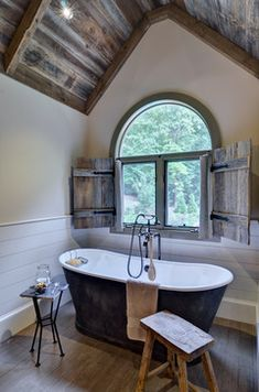 beautiful bathroom ~ love the exposed wood ceiling, plank wood on the walls  the old-fashioned style tub