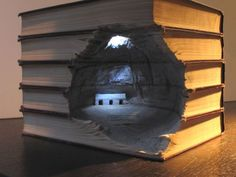 extensively detailed diorama inside a stack of books