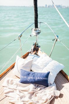 """""""Love you forever"""" nautical pillow decor: http://www.stylemepretty.com/florida-weddings/coral-gables/2015/08/25/glamour-sailing-engagement-in-miami/ 