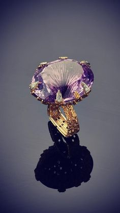 A Yellow Gold Textured Wire Diamond and Amethyst Ring by Andrew GRIMA, 2001.