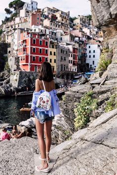 RIOMAGGIORE, ITALY - Fendi floral aplique backpack + Chloe cork wedges