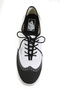these are sexy/// Vans White and Black Oxford Wingtip Authentic Lo Pro Lace-Up Sneakers. $44.99 at Hottopic.