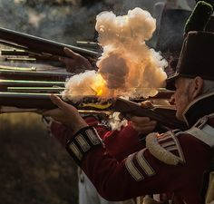 Black powder ignites in the firing pan of a flintlock musket at a Napoleonic war reenactment in Romsey, Hampshire
