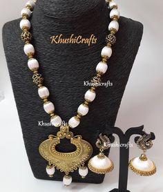 Hand-crafted Silk set consists of a neck piece,a pair of earrings as indicated in the snap crafted in Off White.Silk beads with a combination of metal spacers and an adjustable neck chain! Jhumka Base :app 2.8 cm Note: The product shipped will be same as shown in the picture