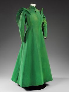 Evening coat  Place of origin: Paris, France (coat, made)  Lyon, France (silk, manufactured)  Date: 1936 (designed)  Artist/Maker: Charles James (designer)  Colcombet (textile manufacturer)  Materials and Techniques: Silk grosgrain  Museum number: T.420-1977 | V&A