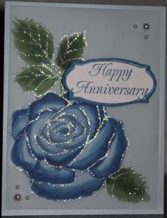 I needed an anniversary card. Her favorite color is blue, his is green. I'm glad that the flash caught the sparkle of the iridescent ice powder. I embossed the flower/leaf stamp and then colored it on the opposite side using the five colors. It was hard to see the embossing on the back side of the vellum! I then used the blender pens to blend the greens and blues on the vellum. I fussy cut a larger mat for the sentiment and, of course, the pearls are hiding adhesive. TFL.