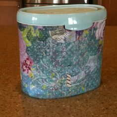 5 minute craft-I used an old Enfamil formula tub, tacky glue, and a scrap piece of scrap book paper to make a storage container.  I'll be storing my nail polish in this tub.