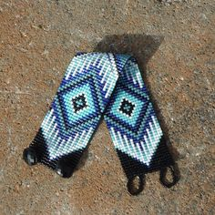 This one of a kind loomed seed bead bracelet was hand woven on a simple loom just Native Americans have done and still do. This bracelet was designed to fit a ladies size 6 1/4 - 6 1/2 wrist. In addition to black and white I have used medium blue, turquoise, and a grey-green color.