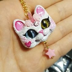 Yay! New ✨Unikitty ✨ pendant, have been working with new smaller glass eyes, came up with this medium size kitty pendant, two more cute faces in progress will appear shortly at my ✨Etsy✨ shop  This one is named Marshmallow  she is white and pink odd eye kitty-unicorn, golden eye is glittery ✨✨✨ #unikitty #unicorn #unicornpendant #catpendant #catpin #catbroosh #kittypendant  #handmadependant #handmadejewelry #polymerclayjewelry #polymerclaycharms #catcharm #collectibledoll #catrel